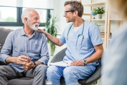 Male nurse talking to and older gentleman